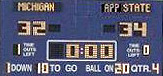 The final score on the Big House scoreboard says it all
