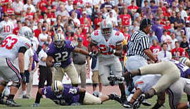 Chris Beanie Wells, on one of his 24 carries, had 134 yards and a touchdown as the Buckeyes defeated Washington 33-14 in Seatlle