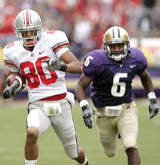 Washington's Vonzell McDowell Jr. (6) chases Ohio State's Brian Robiskie on a 68-yard pass reception for a touchdown early in the second half of a college football game Saturday, Sept. 15, 2007, in Seattle. Ohio State won 33-14.