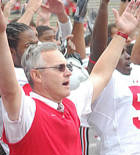 Jim Tressel and the team sing Carmen Ohio after defeating Washington