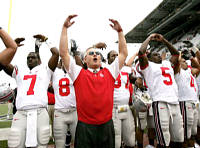 Ohio State coach Jim Tressel, center, begins to form an O as he sings with his players in front of fans after the team's 33-14 victory over Washington in a college football game Saturday, Sept. 15, 2007, in Seattle. (AP Photo/Elaine Thompson)