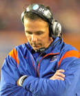 Urban Meyer and Gators everywhere should be embarrassed with Florida's 24 arrests in four years. (Getty Images)