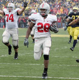Ohio State tailback Chris Wells (28) runs for 62-yard touchdown as tackle Kirk Barton (74) begins to celebrate in the third quarter of a college football game against Michigan Saturday, Nov. 17, 2007 in Ann Arbor, Mich. (AP Photo (AP Photo/Duane Burleson)