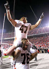 Illinois' Jeremy Leman (47) and Mike Ware (76) celebrate after Illinois defeated Ohio State 28-21 in a football game Saturday, Nov. 10, 2007, in Columbus, Ohio. (AP Photo/Kiichiro Sato)