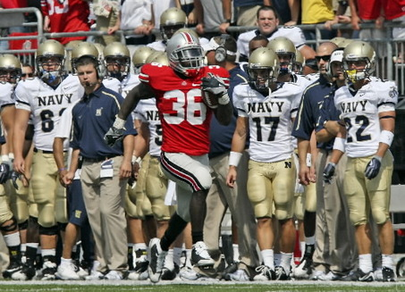 Ohio State's Brian Rolle returns a 2-point-conversion try by Navy for two Buckeyes points with 2:23 left Saturday in Columbus. Photo: Tracy Boulian, The Plain Dealer