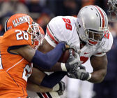 Ohio State's Chris Wells (28) runs through Illinois' Dere Hicks, left, during the first half of the OSU Illinois football game at the University of Illinois in Champaign, Ill., Saturday, Nov. 15, 2008. Ohio State defeated Illinois 30-20. (AP Photo/Seth Perlman)