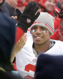 OSU's Terrelle Pryor celebrates with fans after defeating Illinois 30-20 in Champaign, Ill., Saturday, Nov. 15, 2008. (AP Photo/Seth Perlman)