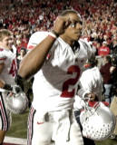A triumphant Terrelle Pryor jogged off the field after the Buckeyes finished off their 20-17 victory over Wisconsin Saturday night. Pryor passed for 144 yards and ran for another 20 and his 11-yard option TD run decided the game with 68 seconds remaining.(Andy Manis/Associated Press)