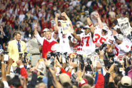 Ohio State Head Coach Jim Tressel and players celebrate after winning the 2002 National Championship in the 2003 Fiesta Bowl, the BCS Title Game