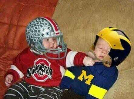Kid Giving The Finger At Michigan Game
