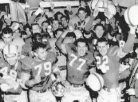 The Buckeyes celebrate after their victory over Michigan in 1954