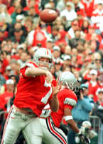 OSU quarterback Joe Germaine fires one of his 28 passes, as running back Michael Wiley protects his blind side, during the Buckeye's 31-16 victory over Michigan, at Ohio Stadium, in Columbus, Ohio, on Saturday, Nov. 21, 1998. Germaine was 16 of 28 for 330 yards and 3 TD's.