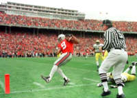 The Buckeye's David Boston heads for the end-zone, with one of his 2-TD receptions, in the Buckeye's 31-16 pasting of Michigan, at Ohio Stadium, in Columbus, Ohio, on Saturday, Nov. 21, 1998. Boston caught 10 passes for 217 yards, which is a record for a receiver against the Wolverines.